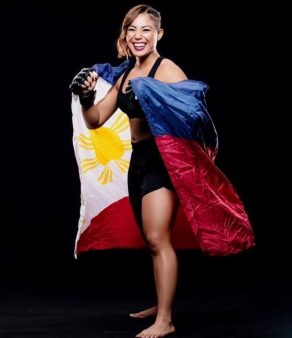 Kyra Batara posing with her flag of the Philippines