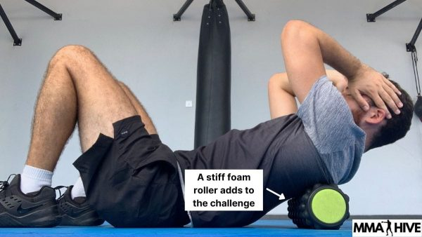 A stiff foam roller gives an extra challenge on the thoracic stretch