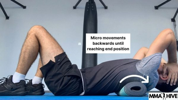 Make micro movements to rotate the thoracic spine backwards whilst breathing deeply