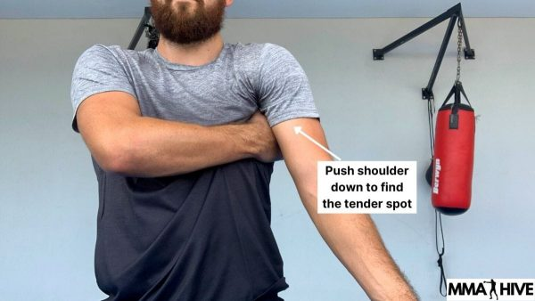 Push your shoulder down around your thumb to find a sore Serratus Anterior muscle