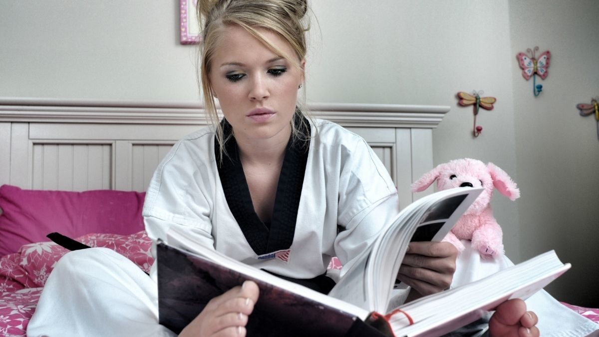 Kenpo Karate student learning from a book