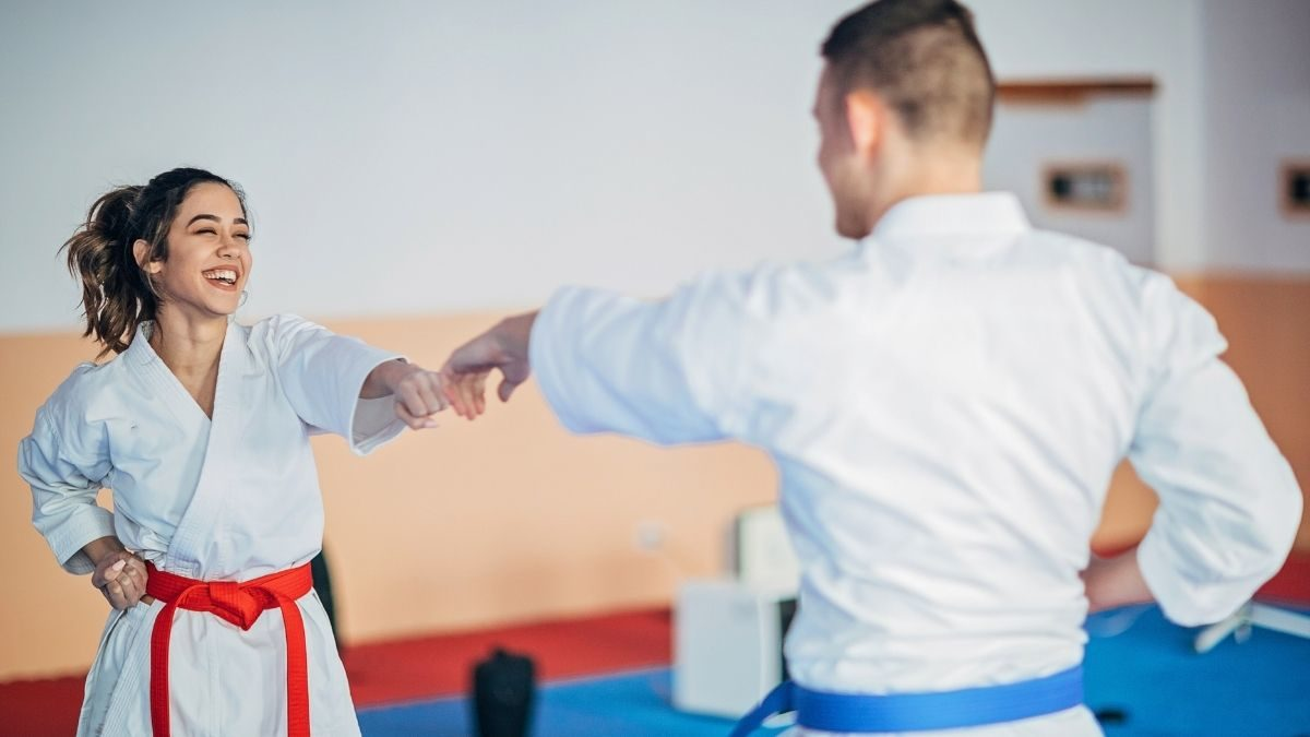 Kenpo Karate teacher showing a student how to punch