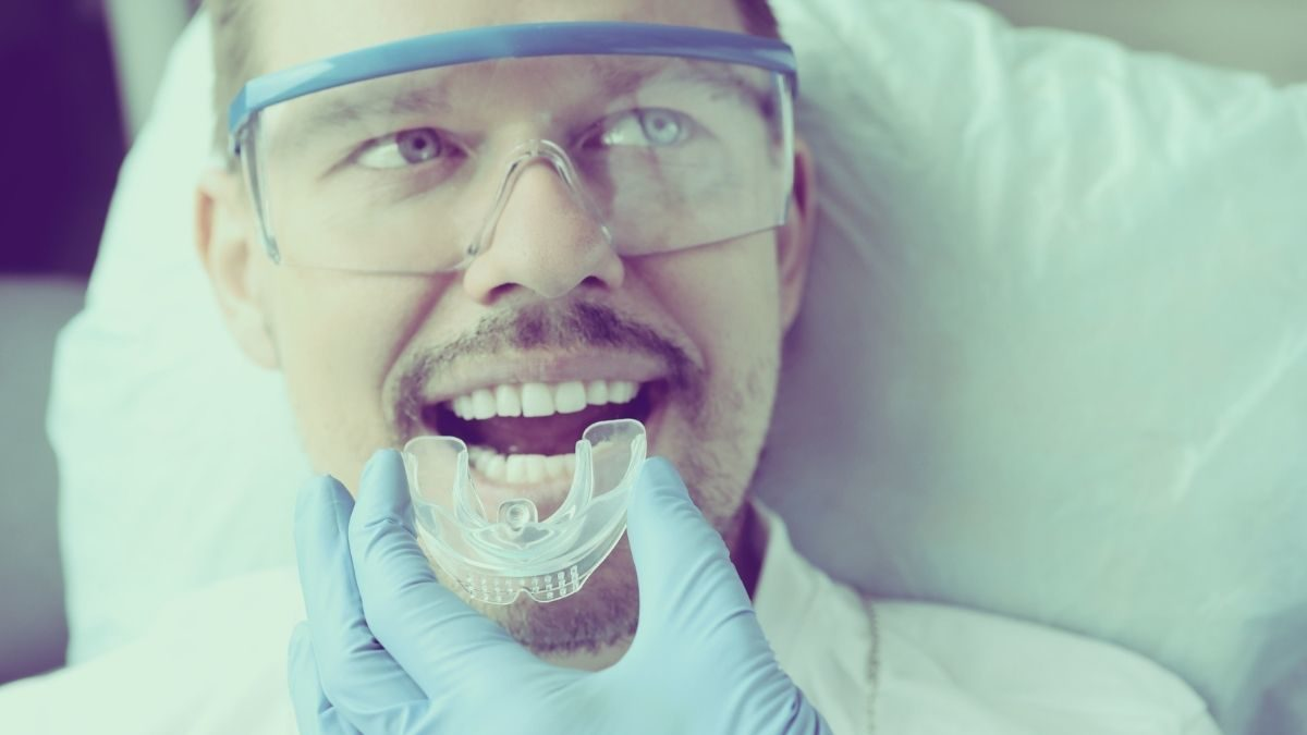 Man getting a mouthguard fitting at the dentist