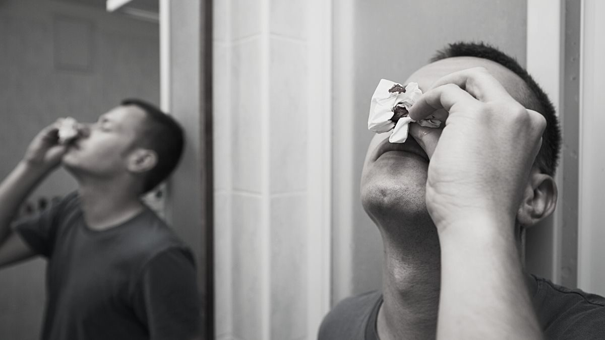 A fighter attending to his broken nose