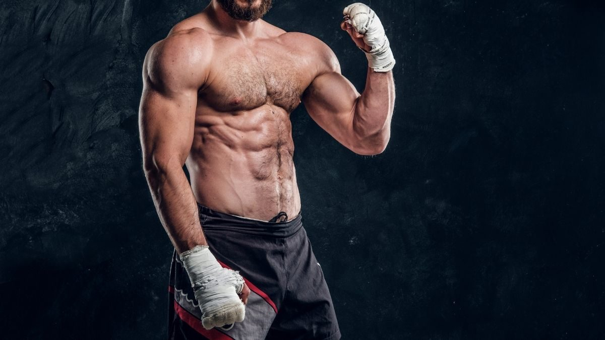 A fighter with a buff and muscular physique