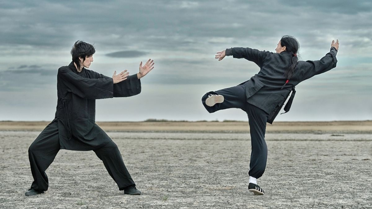 Kung Fu fighters battling on open ground